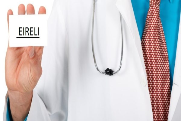 Close up of male doctor holding blank businesscard isolated on white background